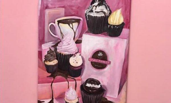 Hannah Arnold Presents Artwork to Smallcakes Cupcakery of Hattiesburg